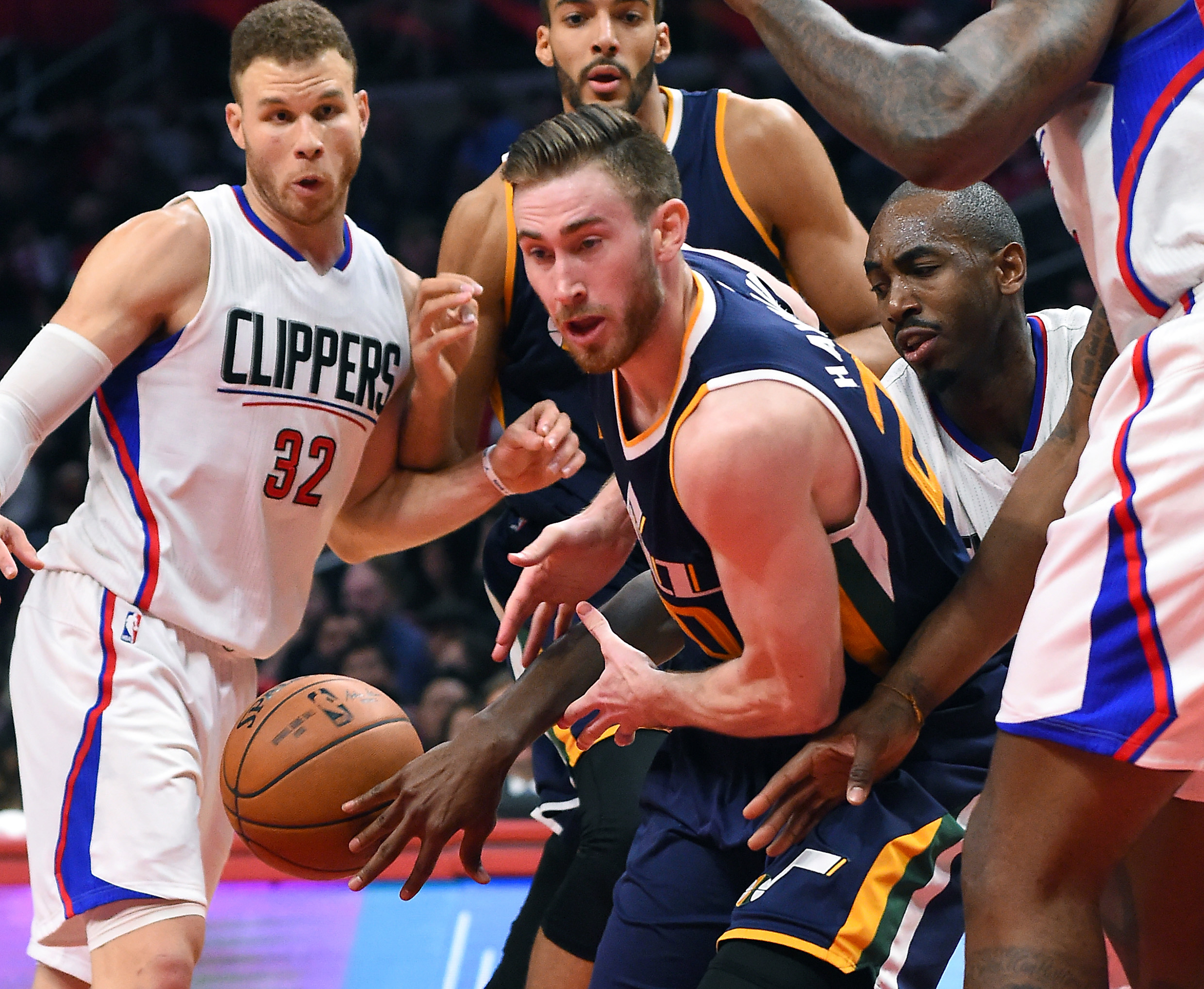 Mar 25, 2017; Los Angeles, CA, USA; Los Angeles Clippers forward Blake Griffin (32) and forward Luc Mbah a Moute (12) defend Utah Jazz forward Gordon Hayward (20) under the basket in the second half of the game at Staples Center. Clippers won 108-95. Mandatory Credit: Jayne Kamin-Oncea-USA TODAY Sports